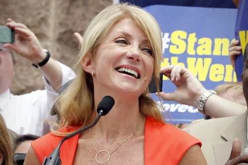 Democratic Senators Wendy Davis and Royce West at a protest before the start of a special session of the Texas legislature in Austin, Texas
